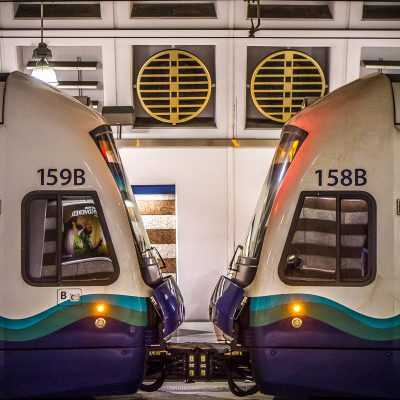 Two Sound Transit light rail vehicles touching