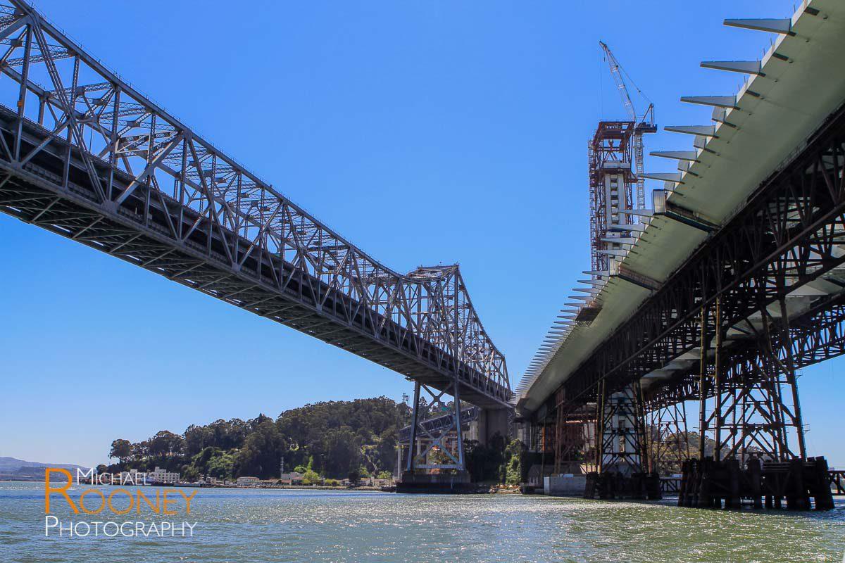 old bay bridge next to self-anchored suspension bridge construction