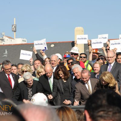 Dignitaries signing a piece of rail at the High Speed Rail groundbreaking ceremony in Fresno, California