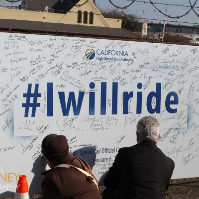 """Signing the """"#IWillRide"""" poster at the California High Speed Rail groundbreaking ceremony in Fresno, California"""