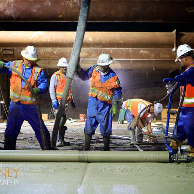 Pouring concrete for the Montague Expressway Trench next to the Milpitas BART Station as part of the BART to Silicon Valley Berryessa Extension project