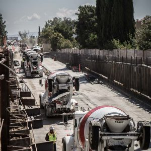 Line of concrete trucks in the Hostetter Trench as part of the BART Silicon Valley Berryessa Extension project in San Jose, California