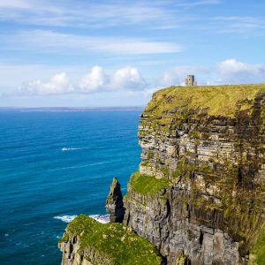 O'Brien's Tower perched atop the Cliffs of Moher in County Clare, Ireland on a sunny day