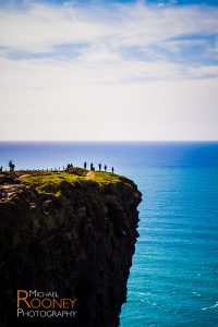 hikers cliffs of moher county clare ireland sunny