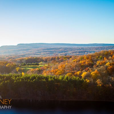 View of fall foliage from Chauncey Peak above the Bradley Hubbard Reservoir in Giuffrida Park in Meriden, Connecticut.