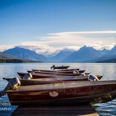 Boats sitting on a dock in Lake McDonald near Apgar in Glacier National Park, Montana