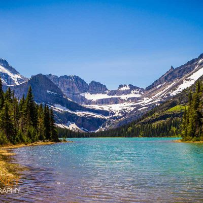 Lake Josephine and Mount Gould on a sunny day in Glacier National Park, Montana