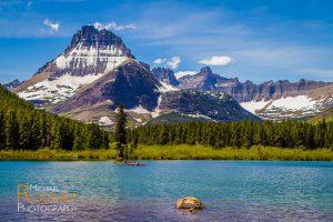 kayakers swiftcurrent lake glacier national park montana