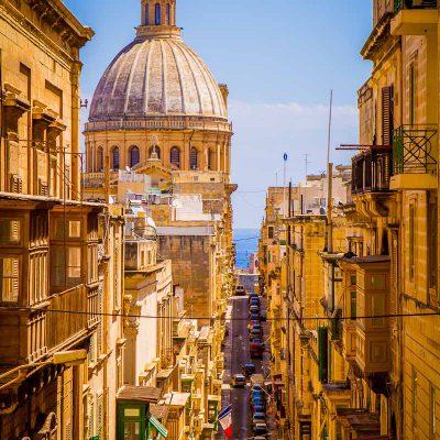 basilica church dome valletta malta mount carmel street narrow steep tourism historic urban