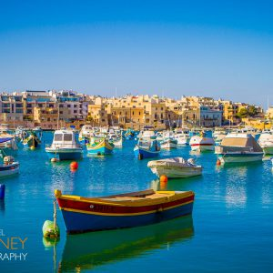 Colorful fishing boats in the harbor of Marsaxlokk, Malta on a sunny day