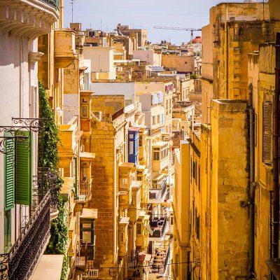 steep narrow alley street historic tourism malta valletta sunny