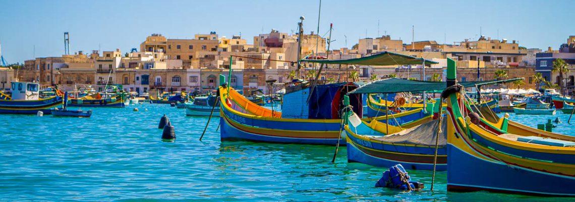 harbor bay water sunny colorful tourism historic fishing boats marsaxlokk malta