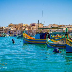 Color fishing boats in the village of Marsaxlokk, Malta on a sunny day