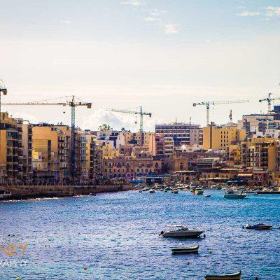 construction high rise towers apartments saint julian bay harbor boat malta urban