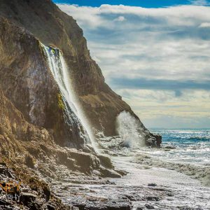 Waves crash below Alamere Falls at Point Reyes National Seashore