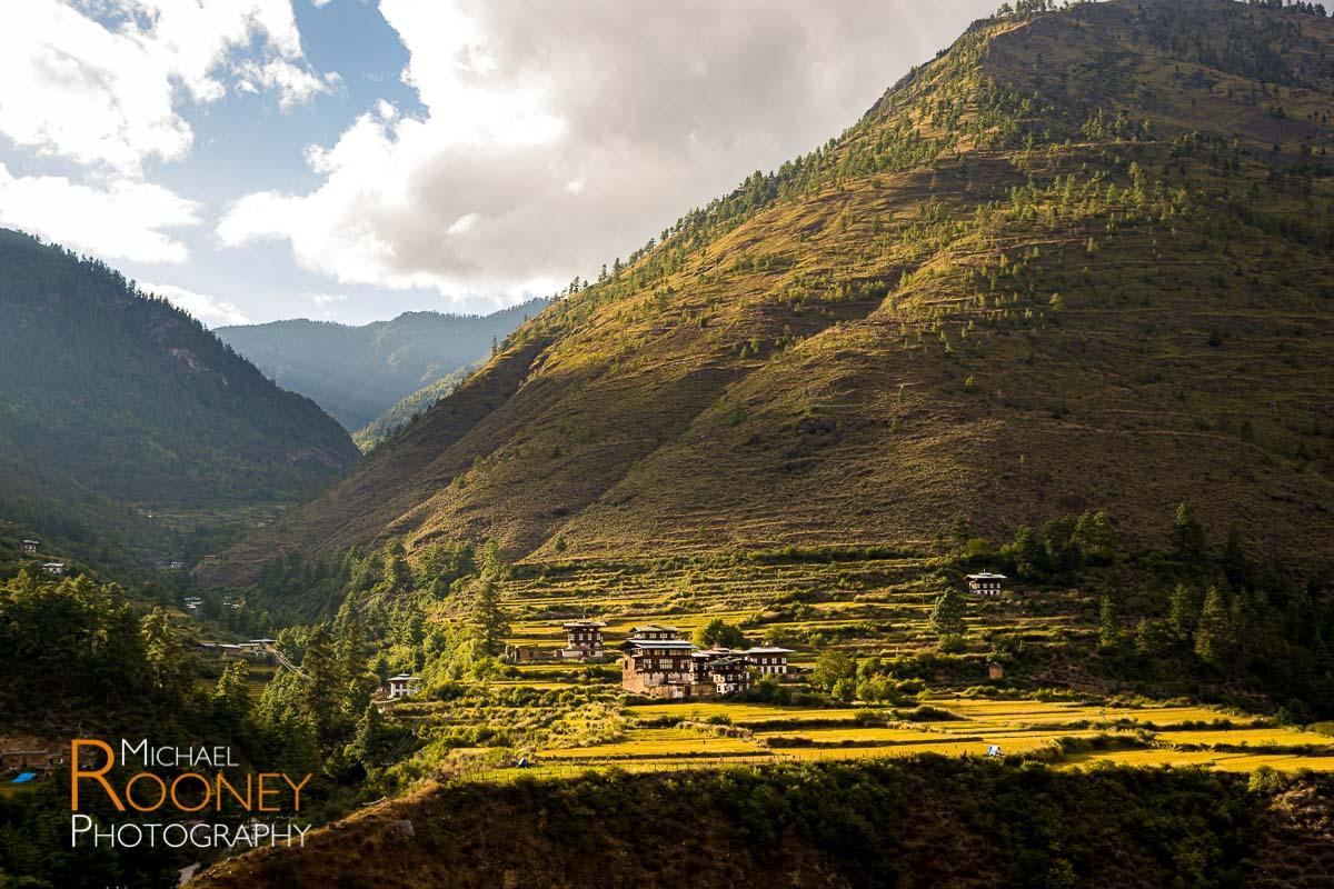 village field mountain sun hill traditional bhutan
