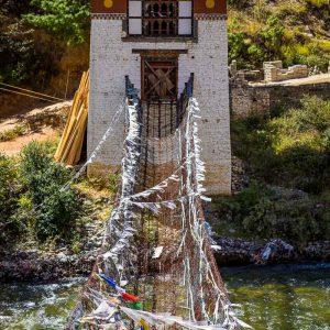 The 15th century Iron Chain Bridge crossing the Paro Chu river at the Tachog Lhakhang Dzong in Bhutan