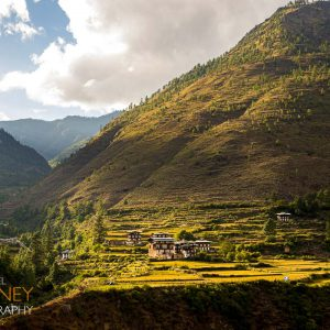 A small traditional village in the sun near Thimphu, Bhutan