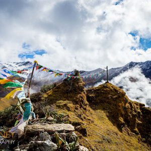 Prayer flags blowing in the wind at the top of the Thombu La Pass in Bhutan