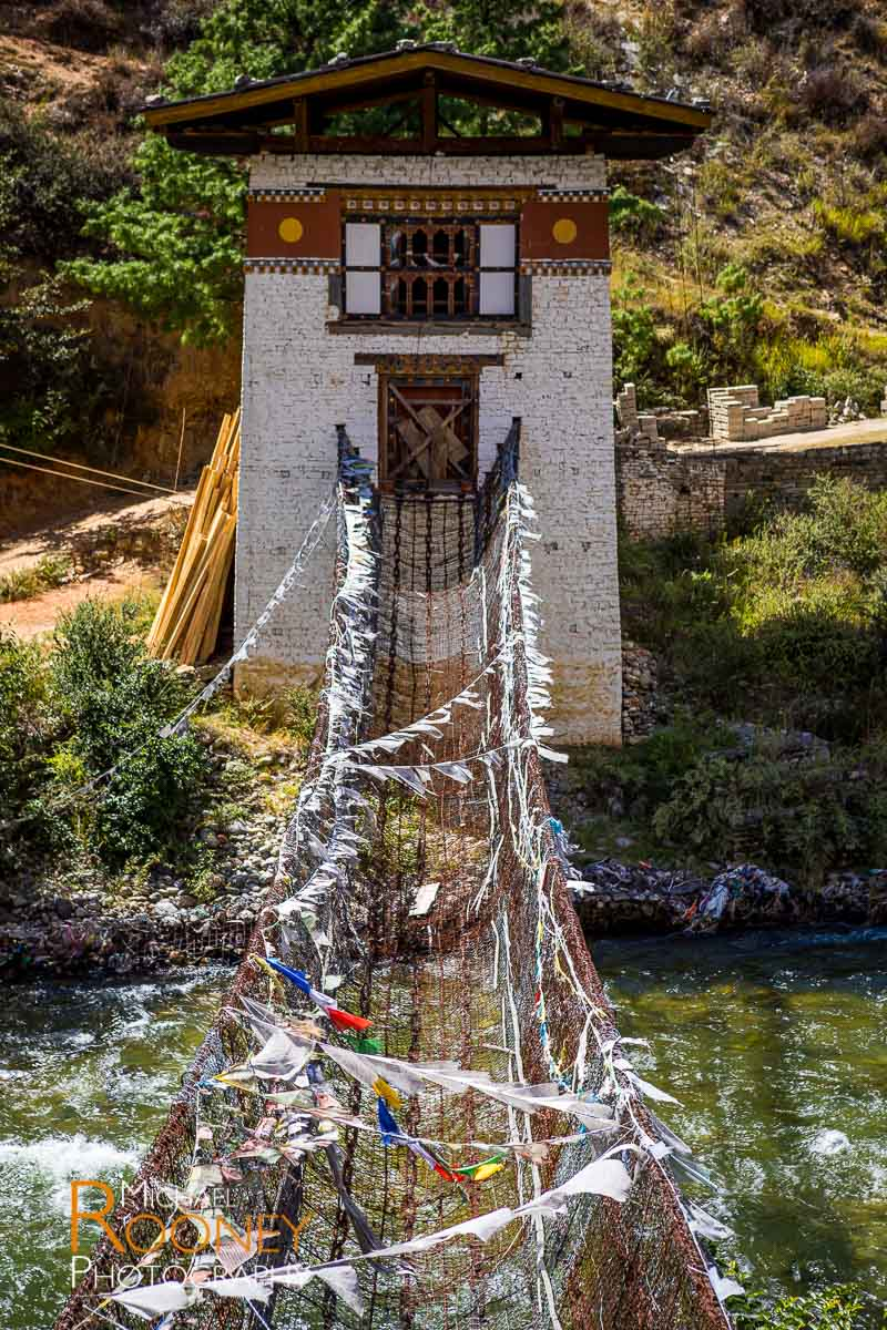 iron chain bridge suspension water old historic river paro chu tachog lhakhang bhutan pray flags