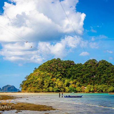 Zipliners above the waters on their way to Depeldet Island in El Nido, Palawan, Philippines