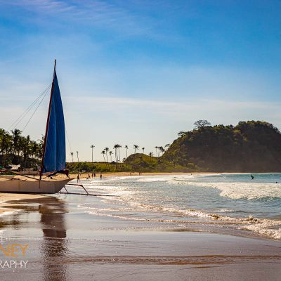 A sailboat on the sand of Nacpan Beach in El Nido, Palawan, Philippines