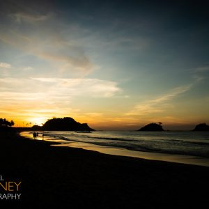 Nacpan Beach and islands in silhouette at dusk in El Nido, Palawan, Philippines