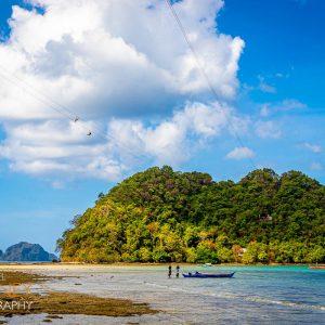 Zipliners above the waters on their way to Depeldet Island in El Nido, Palawan, Philippines