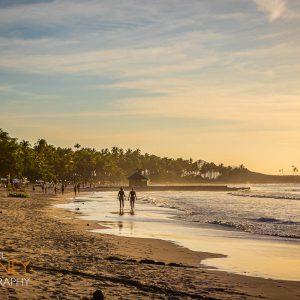 Walkers on Nacpan Beach near dusk in El Nido, Palawan, Philippines