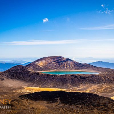 Blue Lake in Tongariro National Park, New Zealand as viewed from the crest of the Alpine Crossing on a sunny day.