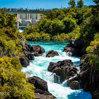 Spectators viewing the Aratiatia Rapids during a release of water on the Waikato River from Aratiatia Dam near Taupo, New Zealand
