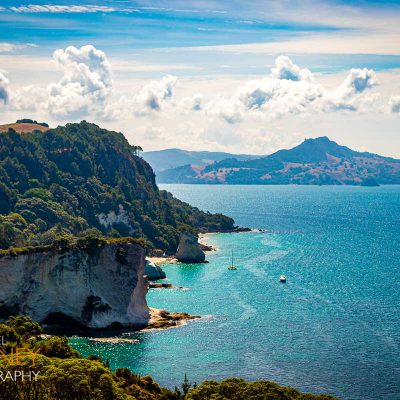 Cliffs near Cathedral Cove and Stingray Bay in the Te Whanganui-A-Hei Marine Reserve near Hahei, New Zealand on a sunny day