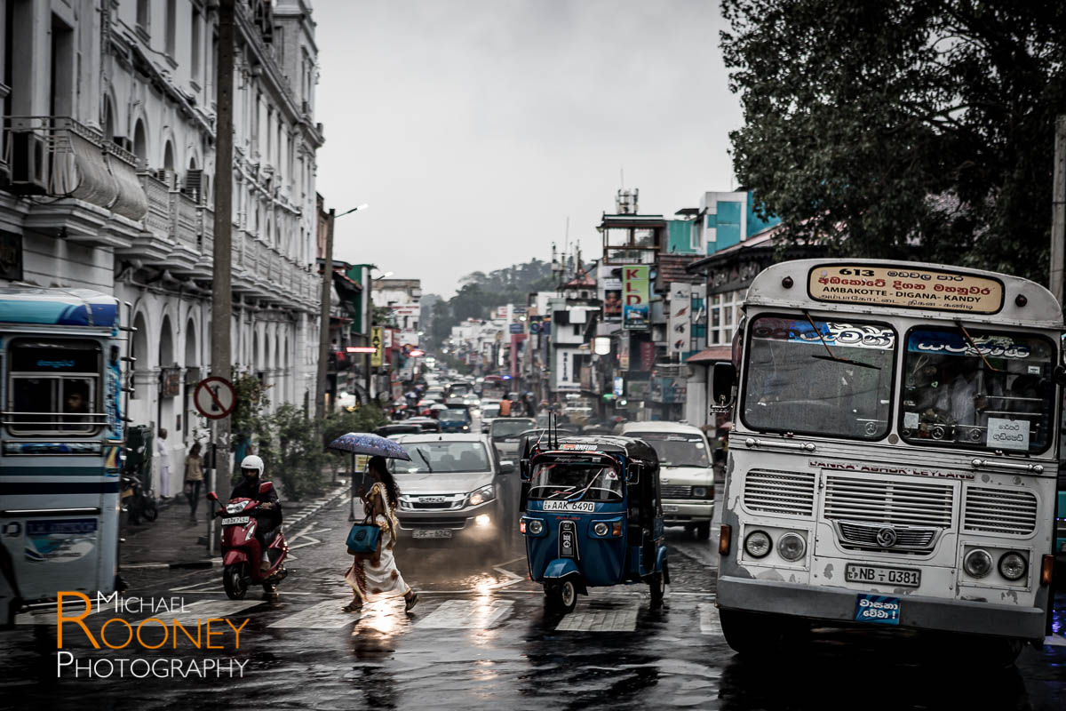 rainy downtown traffic vehicles kandy sri lanka