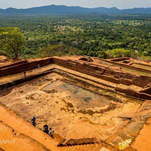 Giant pool atop Sigiriya Rock Fortress in Sri Lanka on a sunny day