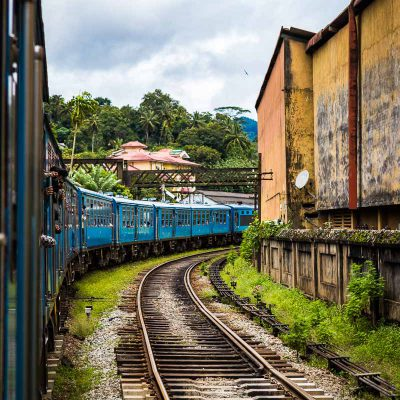 The train to Ella rounds a curve as it passes through a small town in Sri Lanka